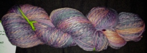 615 yards of Polwarth spun in the Tickled Pink colorway from Into the Whirled